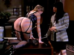 Brunette milf teaches Natasha Sweet a good lesson in spanking scene