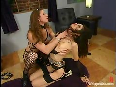 Honey gets her vagina lips twitched and gagged with a dildo