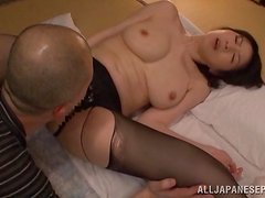 Asian milf in nylons is moaning from a big one