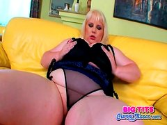 Fat girl in lingerie fondles her body
