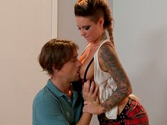 Juggy tettooed babe with hard perky nipples gives blowjob