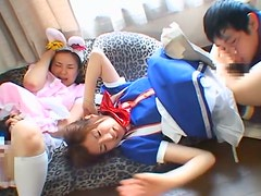 Two girls in costumes get their Asian cunts smashed in foursome scene
