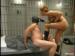 Hot mistress in police uniform dominates a guy in a prison