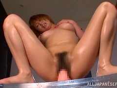 Perfectly hot Japanese chick Rika is riding a dildo