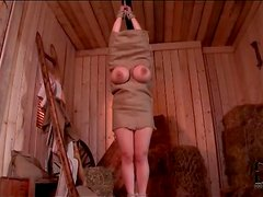 Guys fondle a girl in a burlap sack