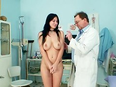 Sexy brunette Roxy Taggart poses in front her doctor