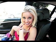Blonde bimbo sucks dick in a car