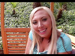 Blonde whore sucks on a hard dick outdoors