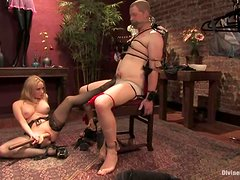 A nerd gets humiliated and tormented by a mistress in BDSM scene