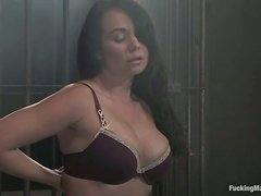 Holly West gets drilled by a machine in bondage