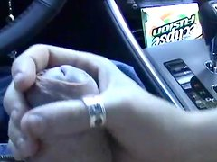 Blonde is wanking a dick in the car