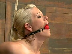 Oiled up blonde gets tied up and toyed in her pussy