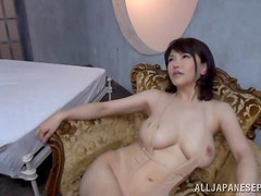 Bombshell asian with big tits gets face-fucked and rides a hard rod.