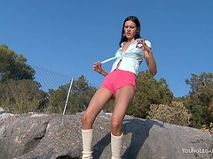 Slim brunette babe Mia enjoys playing with her pussy outdoors