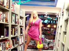 Sassy blonde teen flashes her boobs at the bookstore