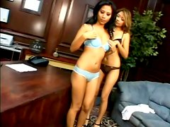 Lana Croft and Nyomi Marcela share a double dildo in an office
