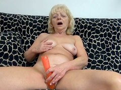 Old granny enjoying her plastic sex toys sticked in her pussy