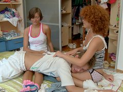 Curly redhead bitch and her GF share a hard cock indoors