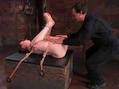 Tied up Lady Kat gets covered with hot wax and toyed