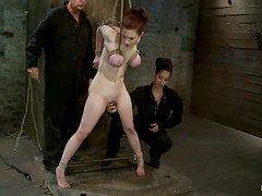 Sexy redhead chick gets her tits and pussy tortured