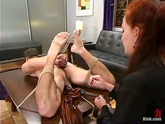 Redhead mistress humiliates a guy and toy his ass