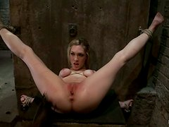 Hog tied blonde gets toyed and fingered in a dungeon