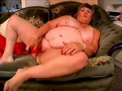 Old fattie Libby satisfies herself with the help of a vibrator