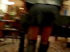 Playing table football in miniskirt, black fishnets