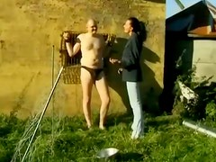 Filthy Slut Tied Poor Guy And Jerks His Cock Outdoors