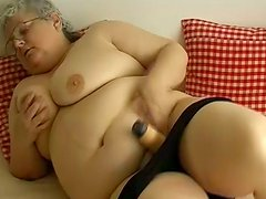 Disgusting BBW granny in glasses plays with huge dildo