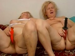 See two frisky BBW grannies poking each other's cunts with dildos