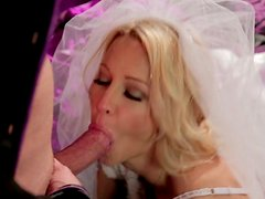 Luscious blonde bride with big tits gives head to the bestman