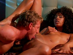 Curly ebony babe gets sweaty while white guy licks her poon