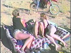 Two couples have wild group sex outdoors in retro video
