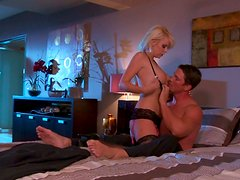 Tempting blonde beauty in stockings gives head in bed