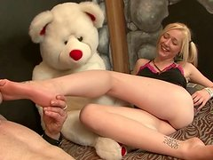 Frisky blonde teen with ponytails gets her smooth soles suckled before giving head