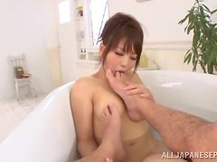 Cute Yuki Kami licks guy's toes and sucks a dick in a bathtub