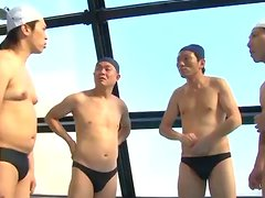 This Japanese girl in a swimsuit is out of the pool and into a gangbang to swim in jizz