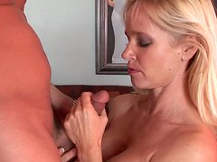 Blonde is touching her boyfriend's dick