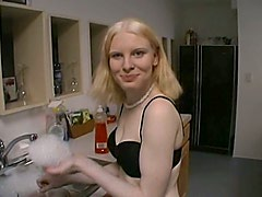 Kinky amateur girl gives a handjob in a kitchen