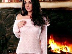 Sexy Brunette Lays in Front of the Fire Fingering Her Pussy