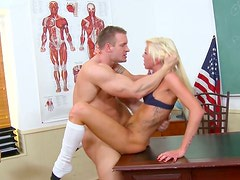 Slender blond college slut gives her head and gets fucked on a table