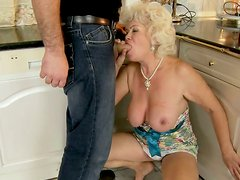 Kinky momma gives blowjob and foot job to one naughty guy