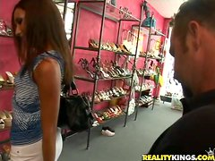 Gorgeous Adriana bends over in the shoe store