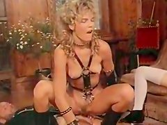 Hot blonde mistress teaches her girlfriend how to ride cock