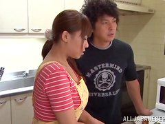 Horny Japanese gives a blowjob to her horny husband in the kitchen.