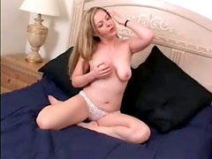 Haley Scott moans with pleasure while fingering her pierced pussy