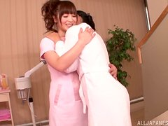 Two Japanese bitches enjoy licking each other's vags indoors