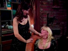 Three lesbian MILFs sit on each others faces and use a strap-on