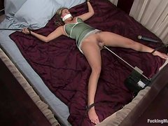 Tied up Delilah Strong gets pleased by a fucking machine